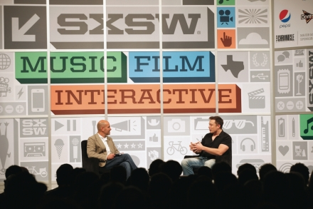 Elon Musk interviewed by Chris Anderson in 2013 (Photo by Sean Mathis, Getty Images)